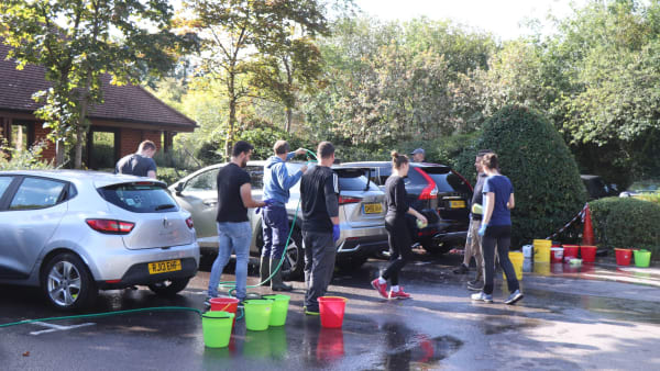Staff from i-transport washing cars
