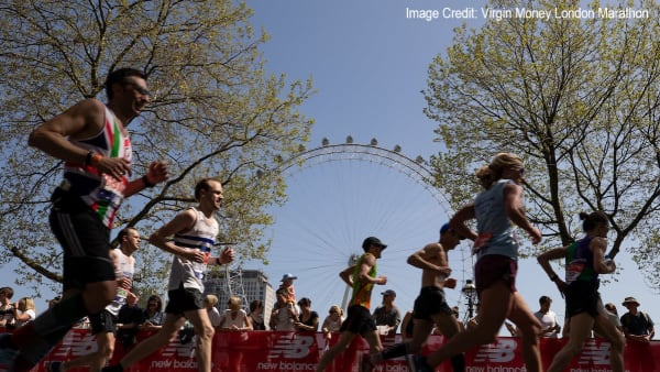 Runners with The London Eye in the background